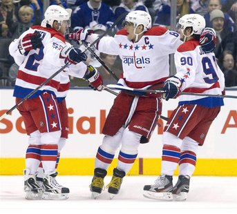 Washington Capitals Alex Ovechkin and Marcus Johansson celebrate a goal scored by Keith Aucoin in their NHL hockey game against Toronto Mapl