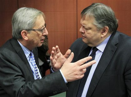 Luxembourg's Prime Minister and Eurogroup chairman Juncker talks with Greece's Finance Minister Evangelos Venizelos at the start of a Eurogr
