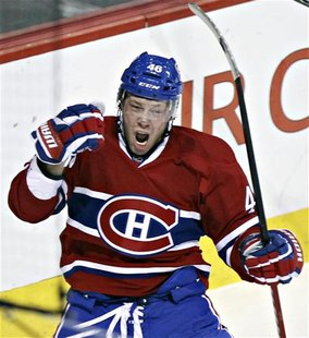 Canadiens Kostitsyn celebrates goal on Islanders' Montoya during first period NHL hockey action in Montreal