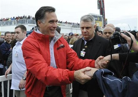 Republican presidential candidate Gov. Romney greets race fans during his appearance at the NASCAR Sprint Cup Series 54th Daytona 500 race a