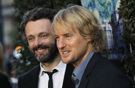 "Cast members Owen Wilson (R) and Michael Sheen pose at the premiere of ""Midnight in Paris"" at the Samuel Goldwyn Theatre in Beverly Hills, California May 18, 2011. The movie opens limitedly in the U.S. on May 20. REUTERS/Mario Anzuoni (UNITED STATES - Tags: ENTERTAINMENT)"