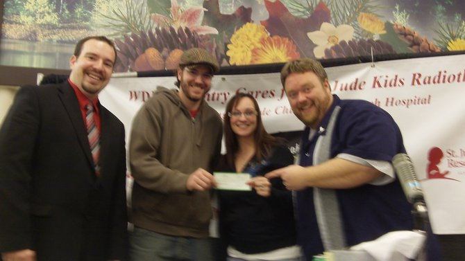 Dave and Kevin from Koo Coo's Nest Comedy Club Check presentation $3000!!
