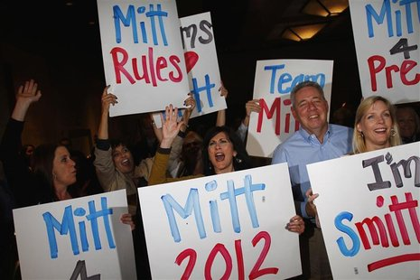 Supporters of U.S. Republican presidential candidate and former Massachusetts Governor Mitt Romney hold signs while they cheer as Romney win