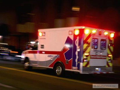 Ambulance rushes to hospital copyright Shutterstock, Inc.