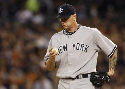 New York Yankees Burnett pauses while pitching to the Detroit Tigers during the first inning of Game 4 in their MLB American League Division