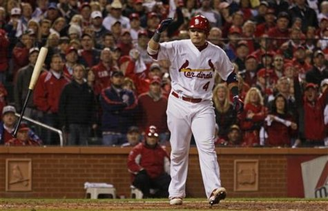 St. Louis Cardinals' Molina throws his bat after drawing a walk with the bases loaded against the Texas Rangers during the fifth inning in G