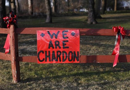 A sign remembering the victims of the Chardon High school shooting in Chardon