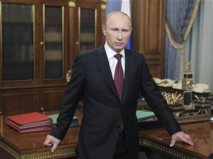 Russian PM Vladimir Putin looks on during his televised speech to address Russian citizens in Moscow