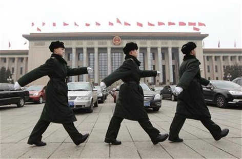 Soldiers of the PLA march in front of the Great Hall of the People in Beijing