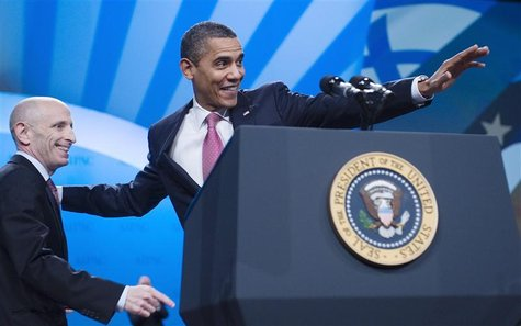Obama stands with Rosenberg as he takes the stage to deliver remarks to AIPAC's policy conference in Washington