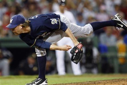 Milwaukee Brewers closer John Axford pitches in the ninth inning against the Boston Red Sox during an MLB Interleague baseball game at Fenway Park in Boston, Massachusetts June 18, 2011. Credit: Reuters/Dominick Reuter