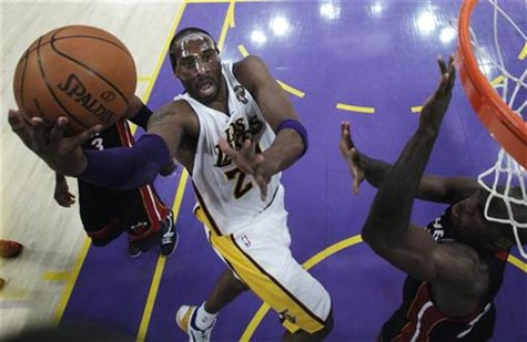Los Angeles Lakers' Bryant goes up to shoot against Miami Heat's Anthony during the first half of their NBA basketball game in Los Angeles