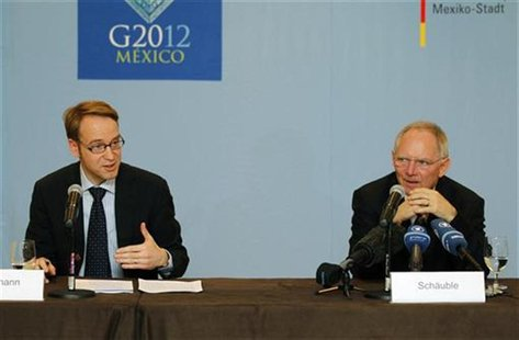 Deutsche Bundesbank President Weidmann and German Finance Minister Schaeuble attend a meeting with media as part of Group of Twenty (G20) le