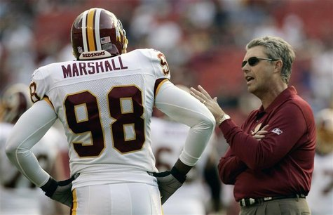 Washington Redskins defensive coach Williams talks to Lemar Marshall prior to their NFL game in Landover, Maryland