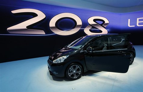 The new Peugeot 208 model car is displayed during the first media day of the Geneva Auto Show at the Palexpo in Geneva