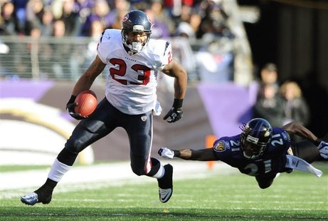 Houston Texans running back Foster gets away from Baltimore Ravens cornerback Webb during their NFL AFC Divisional Playoff football game in