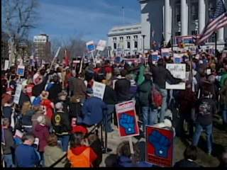Protesters gather on state Capitol in Madison on one-year anniversary of passage of Collective Bargaining law. (courtesy of FOX 11).
