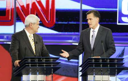 Republican presidential hopefuls (L-R) former Speaker of the U.S. House of Representatives Newt Gingrich (R-GA) and former Massachusetts Governor Mitt Romney at the first New Hampshire debate of the 2012 campaign in Manchester, New Hampshire June 13, 2011. REUTERS/Joel Page (UNITED STATES - Tags: POLITICS)