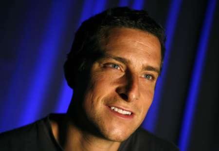 Adventurer Bear Grylls smiles during an interview with Reuters in New York April 23, 2008. To Grylls the flavors of raw grubs, urine and yak eyeballs are fleeting, but the struggle of rationalizing a life of risk won't fade. REUTERS/Mike Segar
