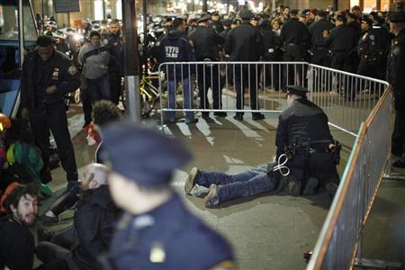 Members of the Occupy Wall St movement are arrested by NYPD officers after protesting at Zuccotti park in New York March 17, 2012.  Credit: Reuters/Eduardo Munoz