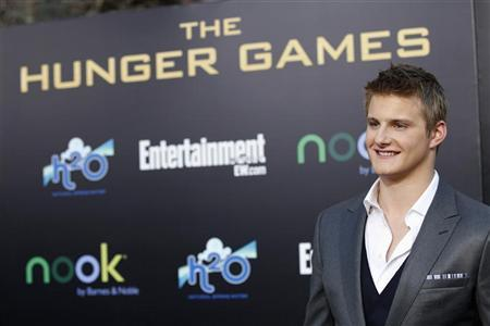 Cast member Alexander Ludwig poses at the premiere of ''The Hunger Games'' at Nokia theatre in Los Angeles, California March 12, 2012.