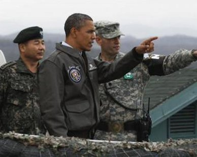 U.S. President Barack Obama visits U.S. military personnel stationed at Observation Post Ouellette along the Demilitarized Zone (DMZ) which borders North and South Korea, outside Seoul, March 25, 2012. U.S. President Barack Obama visited South Korea's tense border with the North on Sunday in a show of solidarity with U.S. ally Seoul and a message of resolve to Pyongyang's new young ruler in his country's nuclear standoff with the West. Credit: Reuters/Larry Downing