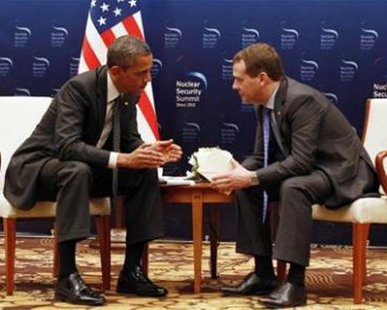 U.S. President Barack Obama (L) speaks to Russian President Dmitry Medvedev in a bilateral meeting before attending the 2012 Nuclear Security Summit in Seoul March 26, 2012. REUTERS/Larry Downing