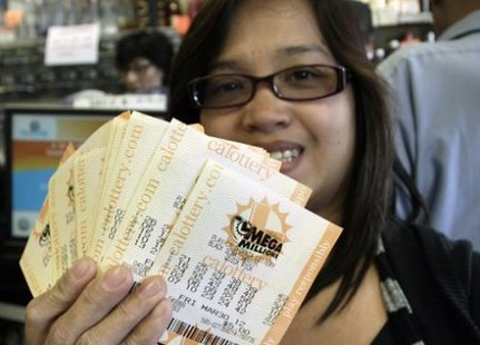 Woman holds Mega Millions lottery tickets (Reuters)