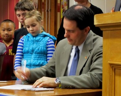Governor Walker signs education reform into law.