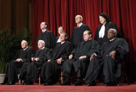 U.S. Supreme Court Justices gather for an official picture at the Supreme Court in Washington