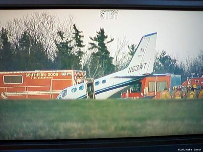 A twin-engine Cessna plane lands after 80-year-old woman is forced to fly plane after husband pilot suffers a medical emergency near Sturgeon Bay. (Photo courtesy of Fox 11 WLUK-TV)