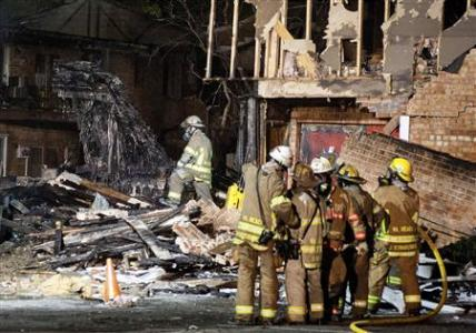 Fire fighters survey the burnt-out wreckage of the tail of a Navy F/A-18D jet fighter which crashed into an apartment complex in Virginia Beach April 6, 2012. Both crew members ejected from the aircraft before it crashed into the buildings and all injuries on the ground were minor according to officials. Credit: Reuters/Rich-Joseph Facun
