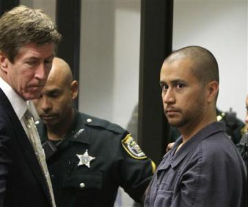 Attorney Mark O'Mara (L) looks on George Zimmerman (R) makes his first appearance on second degree murder charges in the shooting death of Trayvon Martin in courtroom J2 at the Seminole County Correctional Facility in Sanford, April 12, 2012. Credit: Reuters/Gary W. Green/Pool