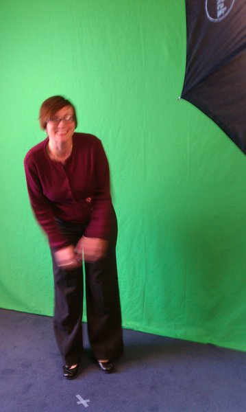 Nikki goofing off in front of the green screen