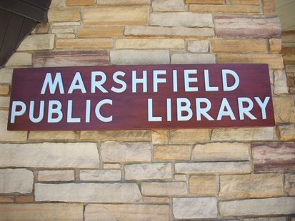 A sign outside the Marshfield Public Library