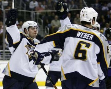 Nashville Predators' David Legwand (L) celebrates with Shea Weber. REUTERS/Lucy Nicholson