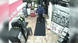 Surveillance photo of the suspect in the armed robbery of the Appleton Marathon gas station at 405 S. Memorial Drive on Thursday April 19, 2012.