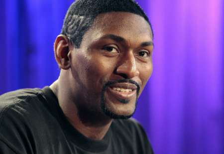 Los Angeles Lakers' Metta World Peace, formerly known as Ron Artest, smiles during a news conference in Los Angeles, California September 21, 2011. World Peace and his non-profit organization Xcel University gave away $285,000 in proceeds from the sale of his 2010 Los Angeles Lakers NBA championship ring to mental health charities from around the country. REUTERS/Jason Redmond (UNITED STATES - Tags: SPORT BASKETBALL ENTERTAINMENT)
