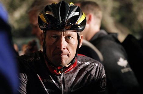 Seven-time Tour de France winner Lance Armstrong awaits the start of the 2010 Cape Argus Cycle Tour in Cape Town March 14, 2010. REUTERS/Mik
