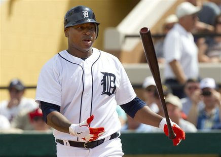 Detroit Tigers' Delmon Young flips his bat after swinging for strike during the second inning of their MLB spring training game against the