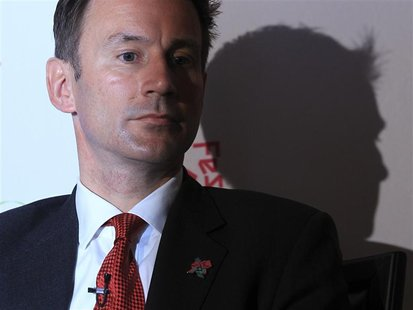 Britain's Culture minister, Jeremy Hunt, listens during the launch of the London 2012 Cultural Olympiad at the Tower of London April 26, 201