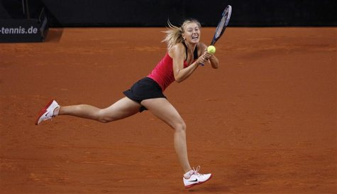 Russia's Maria Sharapova hits a backhand to Belarus' Victoria Azarenka during their women's singles final match at the WTA tennis tournament