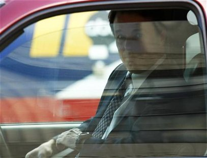 Former U.S. Senator John Edwards sits in a vehicle after leaving the federal court house in Greensboro, North Carolina April 24, 2012. REUTE