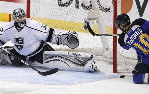 Los Angeles Kings goalie Jonathan Quick (32) makes a save on St. Louis Blues center Andy McDonald (10) in the 3rd period during Game 2 of th