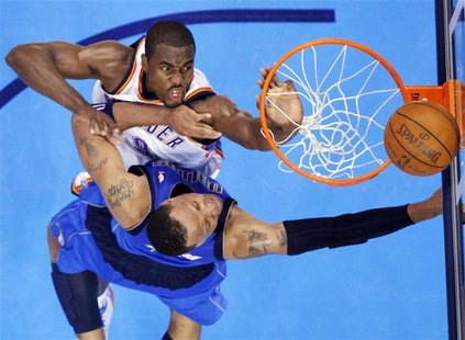 Oklahoma City Thunder's Serge Ibaka (top) contests a shot by Dallas Mavericks' Shawn Marion during the first half of Game 1 of their NBA Wes