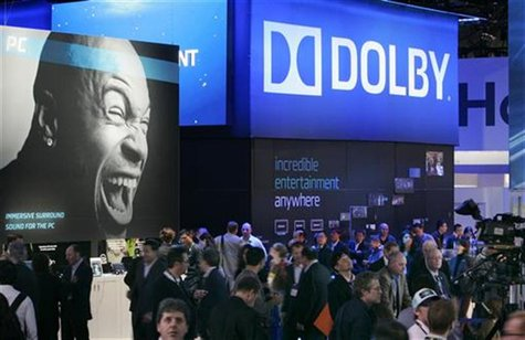 Show-goers pass by the Dolby booth during the 2010 International Consumer Electronics Show (CES) in Las Vegas, Nevada January 7, 2010. REUTE