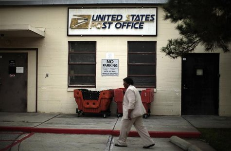 Betty Terry walks past a post office which closed its counter services four years ago at the Veterans Administration in Los Angeles, Califor