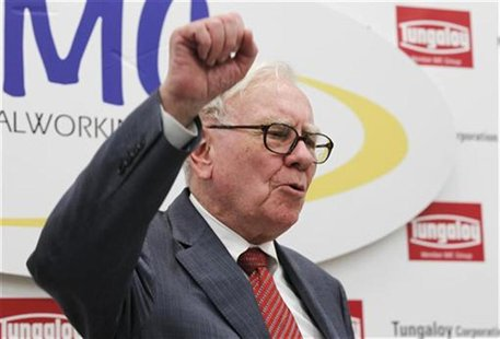 "Berkshire Hathaway Chairman Warren Buffett shouts the slogan ""Never give up, Iwaki"" in Japanese, in response to a request from a local telev"