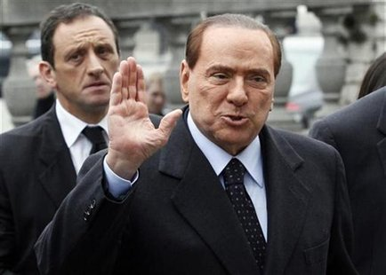 Italy's former Prime Minister Silvio Berlusconi arrives for a meeting of the European People's Party (EPP) ahead of a two-day European Union