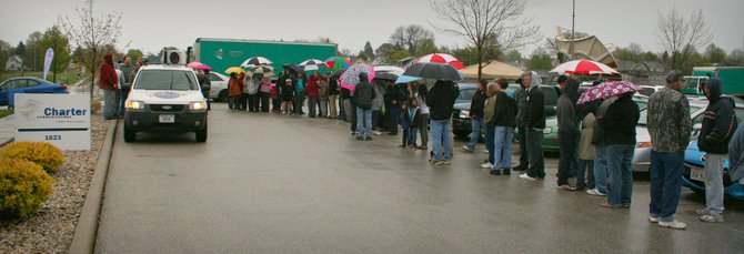 Over 200 people showed up for Wisconsin Dells Season Opener Cards at Charter Communications. The cold rain didn't stop anyone from saving!